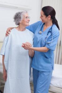 elderly patient helped before knee surgery